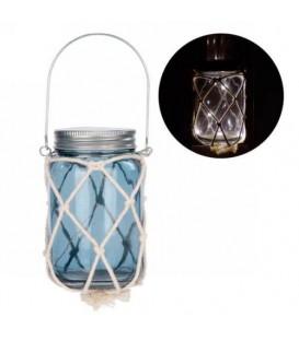 Lanterne en verre bleu illuminée avec filet